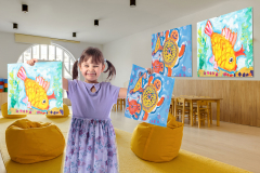 yellow bean bag chairs and wooden tables in kindergarten playing room